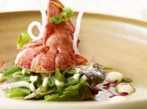Salade van boontjes met kreeft